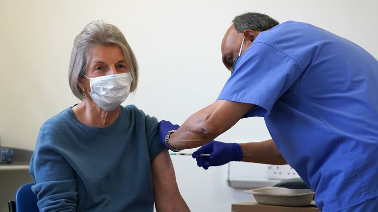 Doctor Abhi Mantgani administers a Covid-19 vaccine booster to Shirley Davies at Birkenhead Medical Building in Birkenhead, Merseyside. Picture date: Saturday October 23, 2021.