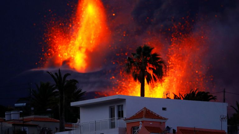 The Cumbre Vieja volcano continues to erupt, as seen from El Paso, on the Canary Island of La Palma, Spain, October 25, 2021. REUTERS/Borja Suarez