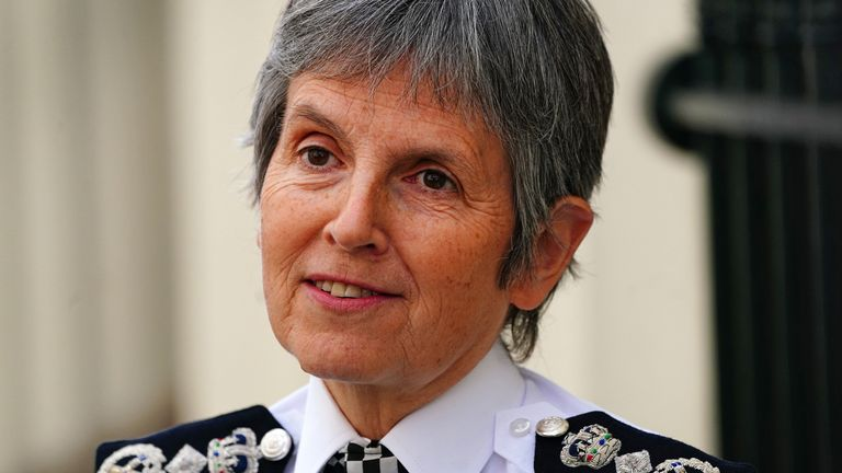 Metropolitan Police Commissioner Dame Cressida Dick alongside police officers during a walkabout in Westminster, London. Picture date: Monday October 4, 2021.