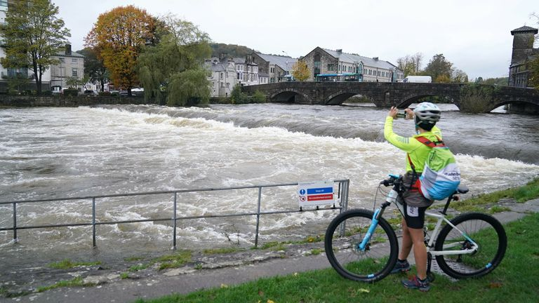 """High water levels on the River Kent in Kendal, Cumbria, where the Met office has warned of life-threatening flooding and issued amber weather warnings as the area was lashed with """"persistent and heavy rain"""". Up to 300mm is expected to fall in parts of the region, which typically sees an average of 160mm in October. Picture date: Thursday October 28, 2021. High water levels on the River Kent in Kendal, Cumbria, where the Met office has warned of life-threatening flooding and issued amber weather"""