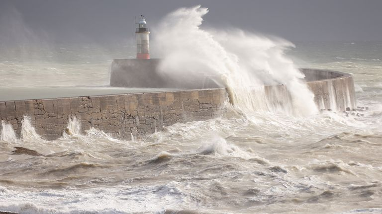 Large waves hit the harbour wall in Newhaven, Britain, October 20, 2021. REUTERS/John Sibley