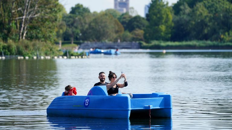 Visitors travel by pedalo along the Serpentine, Hyde Park, London. Picture date: Tuesday September 21, 2021.