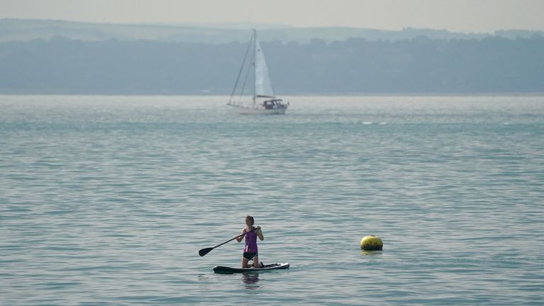A paddle boarder in the sea off of Southsea beach in Hampshire. Picture date: Wednesday September 22, 2021, 2021.