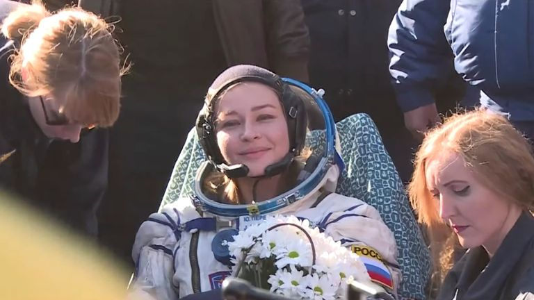Yulia Peresild smiles after landing on the Kazakh steppes after 12 days in space. Pic: Roscosmos via Reuters
