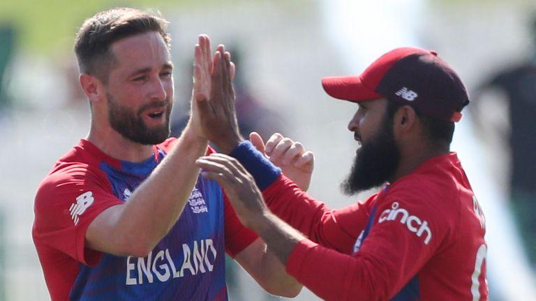 England's Adil Rashid (R) celebrates a wicket with Chris Woakes against Bangladesh