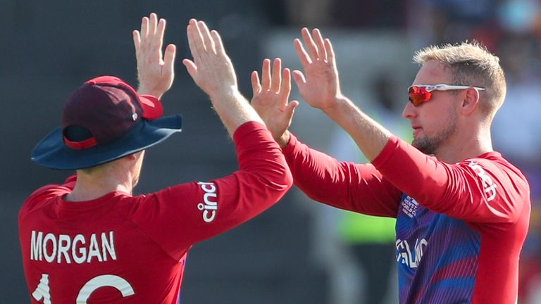 Liam Livingstone (R) celebrates a wicket with England captain Eoin Morgan at the T20 World Cup (Associated Press)