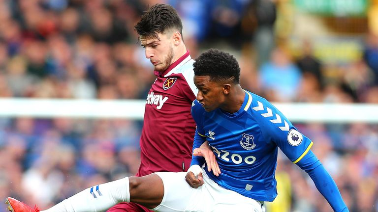 Everton's Demarai Gray and West Ham's Declan Rice battle for the ball
