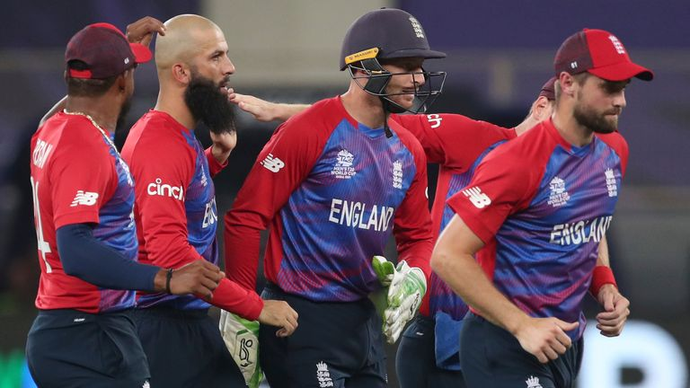England's Moeen Ali, second left, celebrates with teammates after taking the wicket of West Indies' Lendl Simmons caught by England's Liam Livingstone during the Cricket T20 World Cup match between England and the West Indies at the Dubai International Cricket Stadium, in Dubai