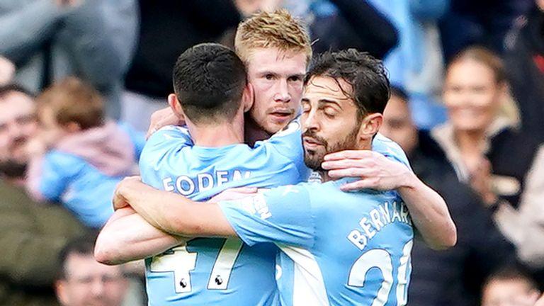 Kevin De Bruyne embraces teammates after scoring Man City's second goal