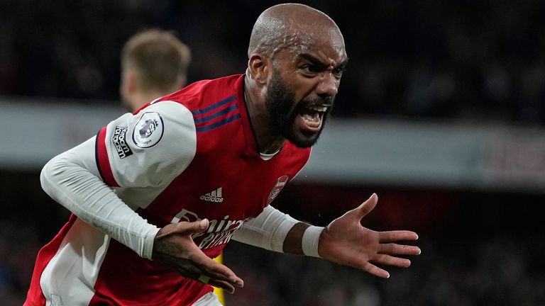Arsenal's Alexandre Lacazette celebrates after scoring his side's second goal to equalize the match during an English Premier League soccer match between Arsenal and Crystal Palace at the Emirates Stadium in London, England, Monday Oct. 18, 2021. (AP Photo/Alastair Grant)