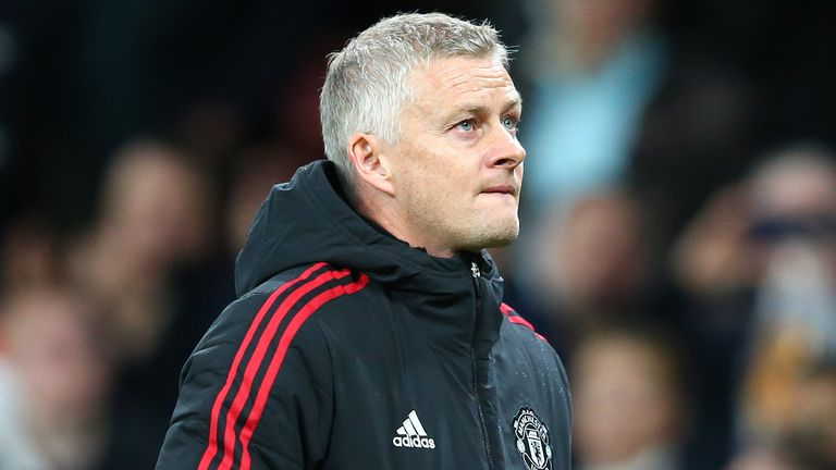 Manchester United manager Ole Gunnar Solskjaer walks off the pitch at full-time against Liverpool