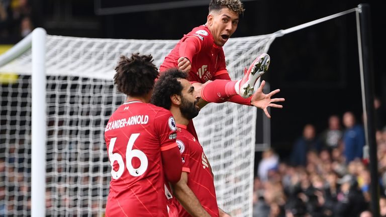 Mohamed Salah celebrates with teammates Trent Alexander-Arnold and Roberto Firmino after scoring Liverpool's fourth