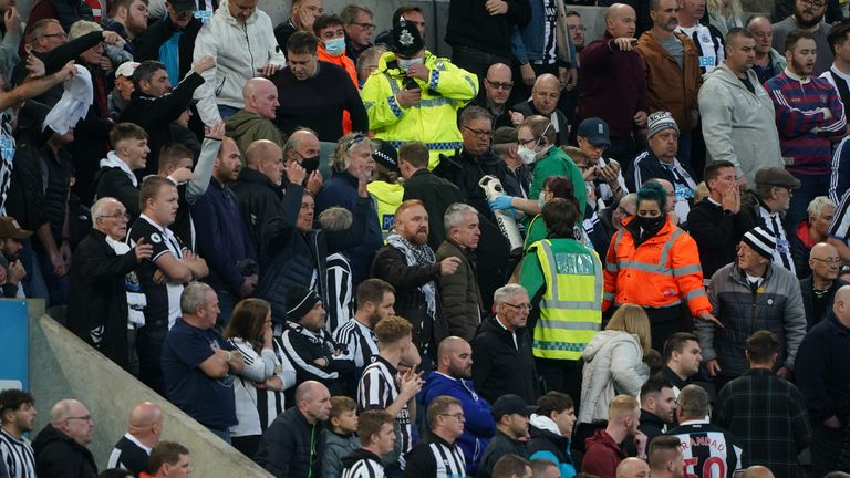 PA - Medical teams assist a fan who suffered a suspected cardiac arrest in the stands during Newcastle's game against Tottenham