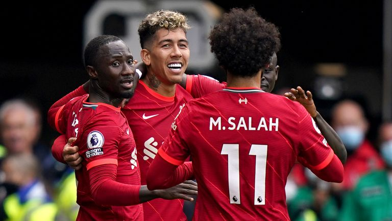 Roberto Firmino celebrates his goal with teammates